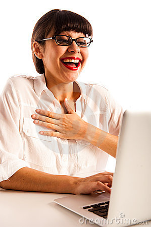 Woman with glasses, surprised and happy at laptop