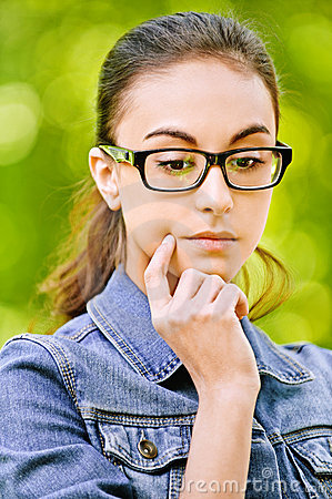 Woman in glasses thoughtfully