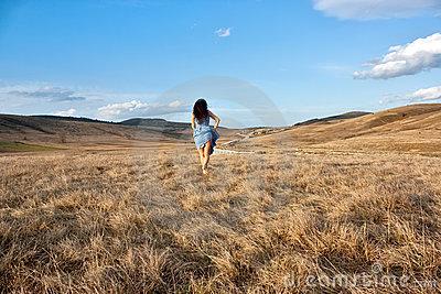 Woman goes to grass by the road