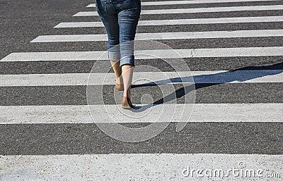Woman going on the crosswalk