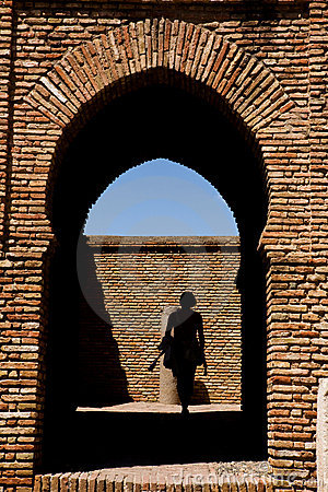 Woman going through the gateway in Alcazaba castle