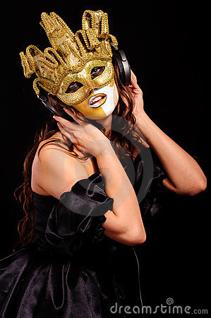 Woman in golden half mask