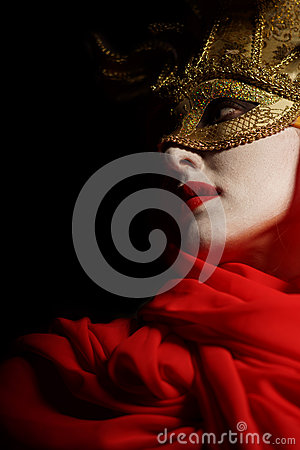 Woman in golden party mask