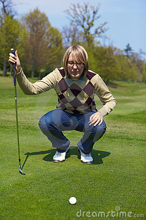 Woman on the golf course preparing