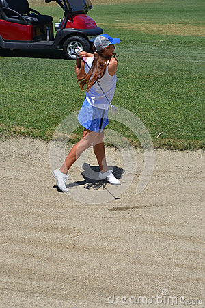 Woman Golfer Hitting Out of Sand