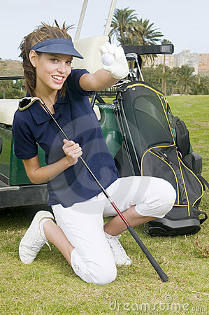 Woman golfer holding a golf ball