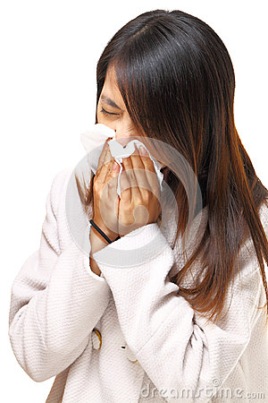 Woman with cold sneezing