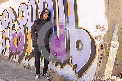 Woman at the graffiti brick wall