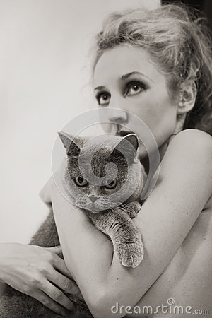 Woman with a gray British cat