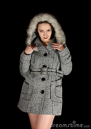 Woman in gray coat on black background