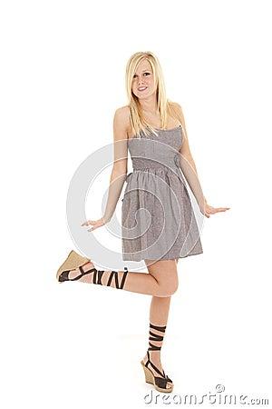 Woman gray dress leg up