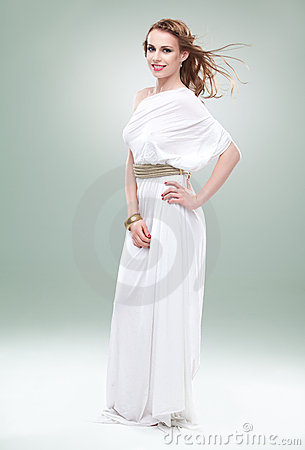 Woman in greek inspired white dress, smiling,