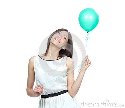 Woman with green balloon thinking