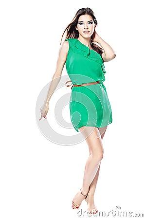 Woman in green dress barefoot