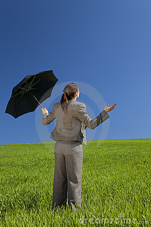 Woman In A Green Field With An Umbrella