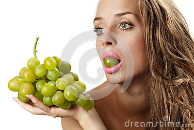 Woman with green grape