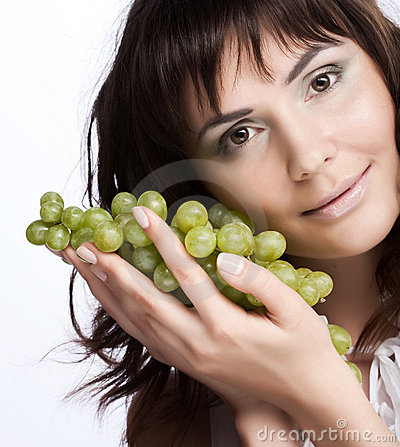 Woman with green grapes
