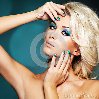 Woman with green nails and glamour makeup of eyes