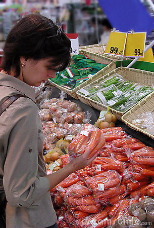 Woman at the greengrocery