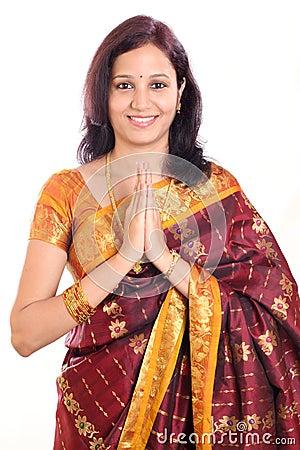 Woman greeting namaste