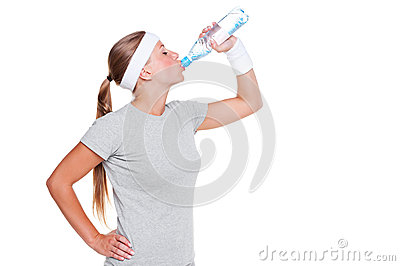 Woman in grey t-shirt drinking water