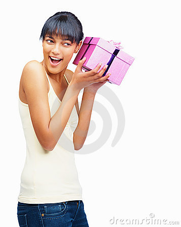 Woman guessing the gift by putting it to her ears