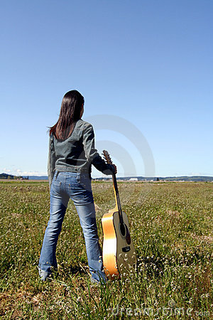 Free Woman Guitar Player Stock Image - 703171
