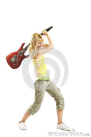 Woman guitarist breaking her guitar