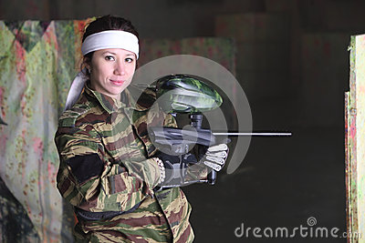 Woman with gun for paintball