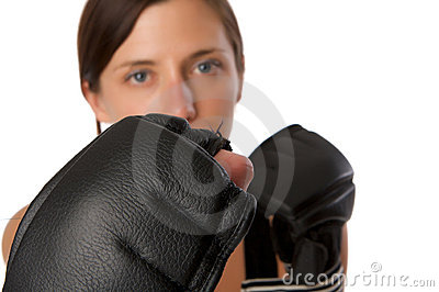 Woman in gym clothes, with boxing gloves, strength