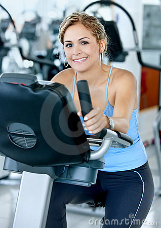 Woman at the gym cycling