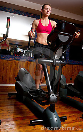 Woman in gym on stepper