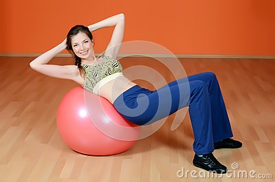 The woman with a gymnastic ball