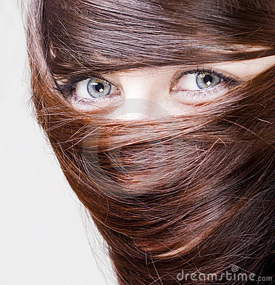 Woman with hair around the eyes