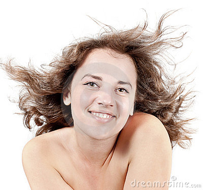 Woman with hair blown by wind on white