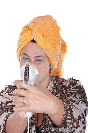 Woman with the hair dryer for hai