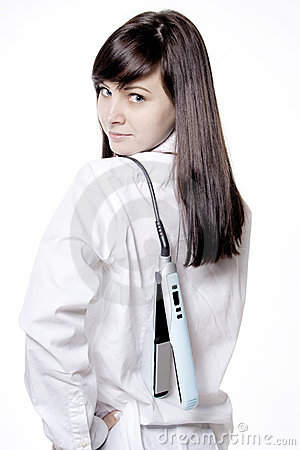 Woman with hair iron