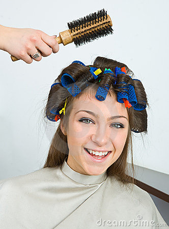 Happy woman with hair rollers in her hair.