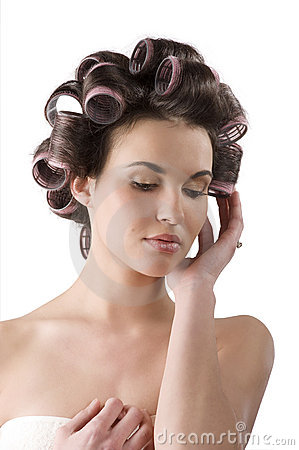 Woman with hair rollers