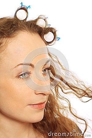 Woman in hair rollers