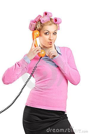 Woman with hair rollers talking on a phone