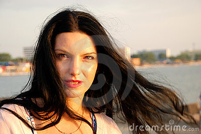 Woman with hair in wind at sea