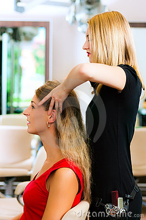 Woman at the hairdresser getting a head massage