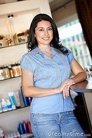 Woman hairdresser standing in salon