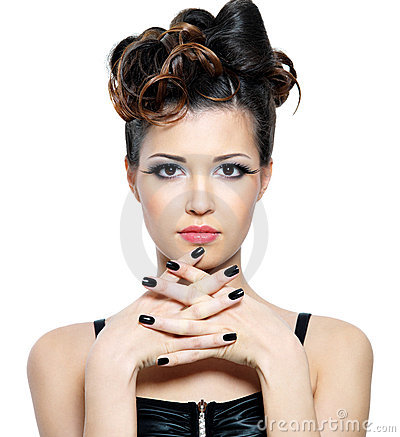 Woman with hairstyle and black fingernails