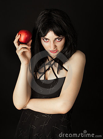 Woman with halloween make up holding red apple
