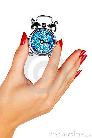 Woman hand with a clock