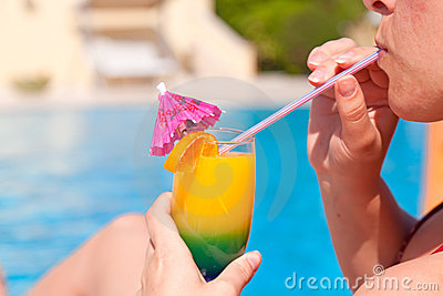 Woman hand drinking cocktail Stock Photo