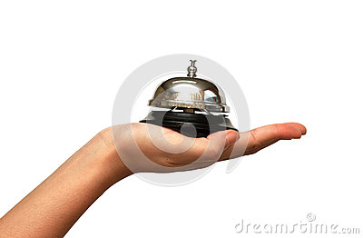 Woman hand giveing  a hotel service bell