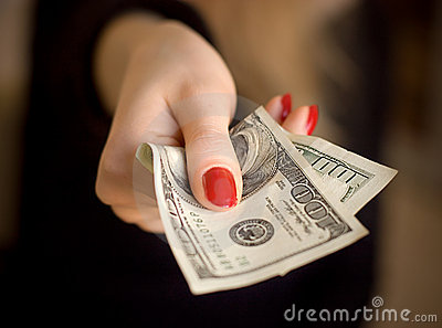 Woman hand giving money